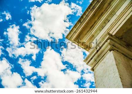 Classical architectural detail of Punta della Dogana in Venice on blue cloudy sky - stock photo