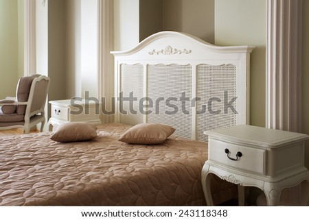 Classical bedroom interior with white side tables  - stock photo