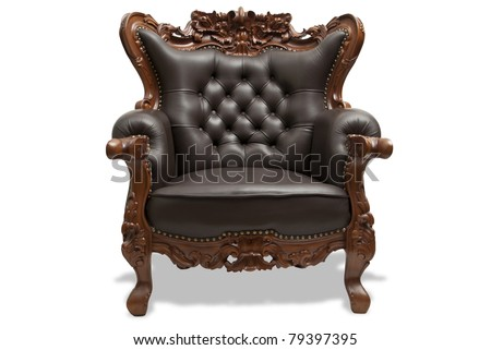 classical carved wooden chair upholstered in leather - stock photo