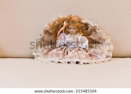 classical ceramic doll - stock photo