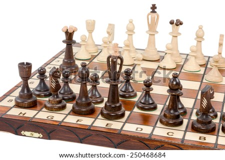 Classical checkerboard with chess closeup isolated on a white background - stock photo