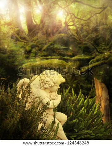 Classical cherub angel in mystical garden setting with rays of light streaming above - stock photo