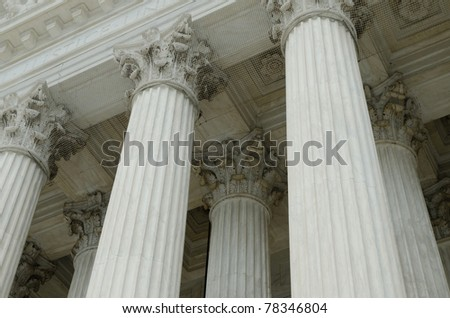 Classical columns with portico detail - stock photo