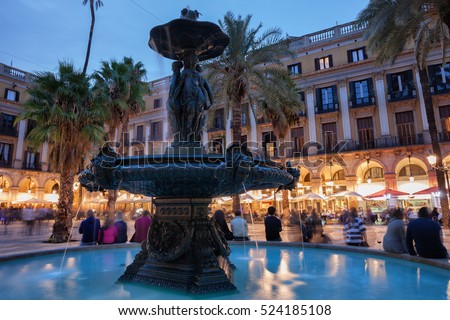 Classical Fountain of the Three Graces at Placa Reial in city of Barcelona in Catalonia, Spain at dusk