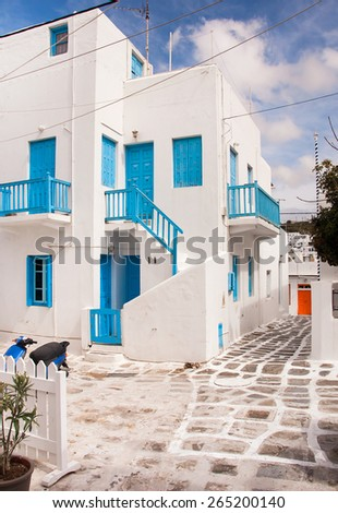 Classical Greek architecture of the streets - stairs, balconies, painted pavement - stock photo