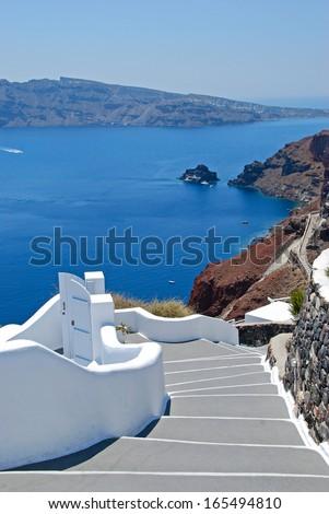 Classical greek architecture with caldera background in Firostefani - Santorini island  - stock photo