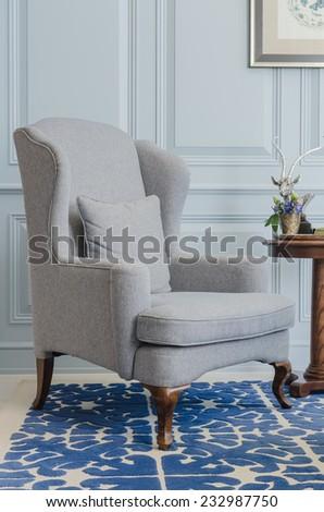 classical grey chair style on blue pattern carpet - stock photo