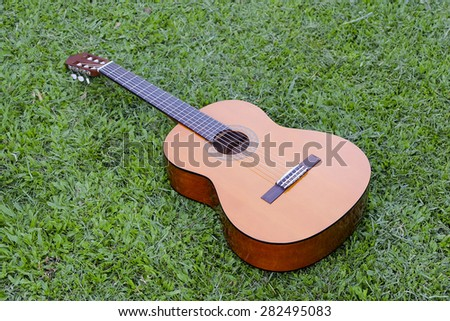 Classical guitar on field