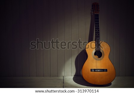 Classical guitar on wooden background - stock photo
