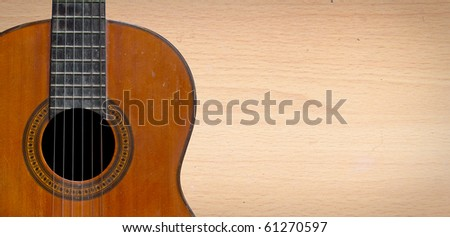 Classical guitar with nylon strings on plywood background - stock photo