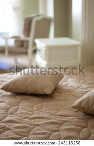 Classical interior of a bedroom with two pillows on a bed - stock photo