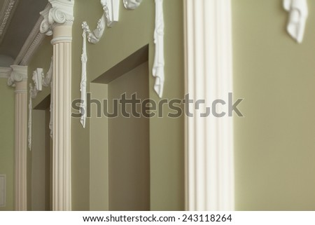 Classical interior of a wall with plaster moldings - stock photo