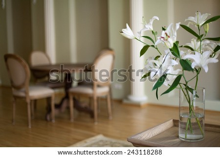 Classical interior of dining room with round dining table and chairs - stock photo