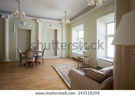 Classical interior of living room with a couch and dining table - stock photo