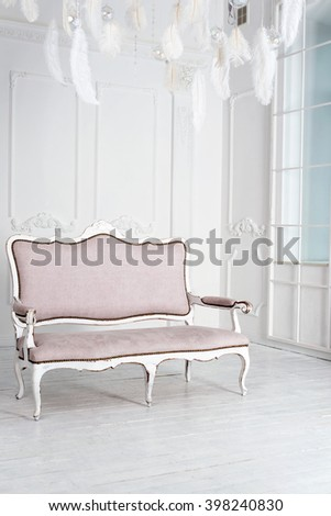 Classical interior with pink sofa. White modern interior with panoramic windows and sofa - stock photo