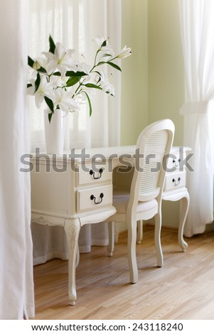 Classical interior with white desk and white curtains