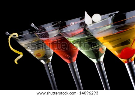 Classical martini in chilled glass over black background on reflection surface, garnished with fresh blackberry, maraschino cherry, marinated pearl onions, olive and lemon twist. - stock photo