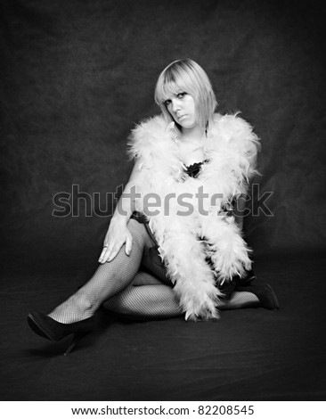Classical monochrome shot of a beautiful woman posing on a black background. - stock photo