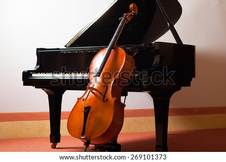 Classical music concept: violin leaning on a piano