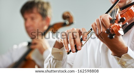 Classical music: Violinist playing at the concert - stock photo