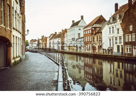 Classical old houses at water canal in european city. Bruges (Brugge), Belgium. Image used vintage tone filter.