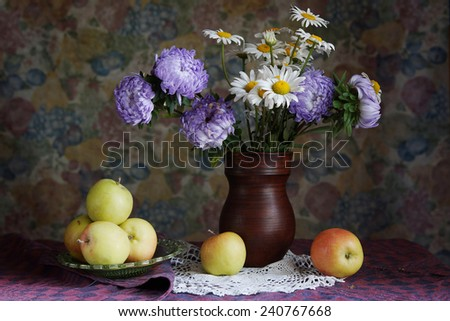 Classical still life with apples and beautiful flowers into a vase - stock photo