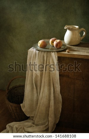 Classical still life with three peaches and a jar - stock photo