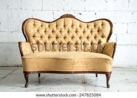 Classical style Armchair sofa couch in vintage room - stock photo
