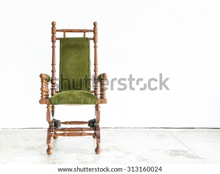 Classical style rocking chair with green wool on white background - stock photo