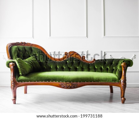 Classical style sofa in a white room - stock photo