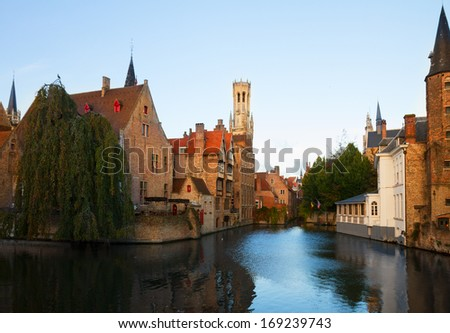 classical view of old town of Bruges with Belfort tower, Belgium