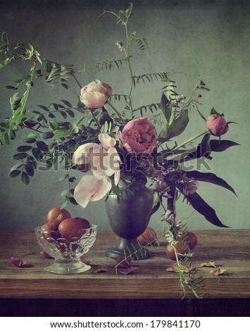 Classical vintage still life with peonies and plums - stock photo