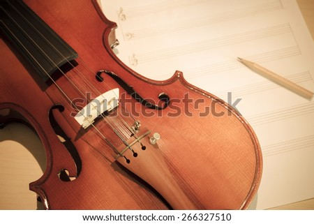 classical Violin on blank Music sheet, soft & dramatic tone processed for music composer concept background - stock photo