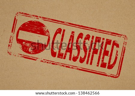 Classified rubber stamp symbol on brown paper background