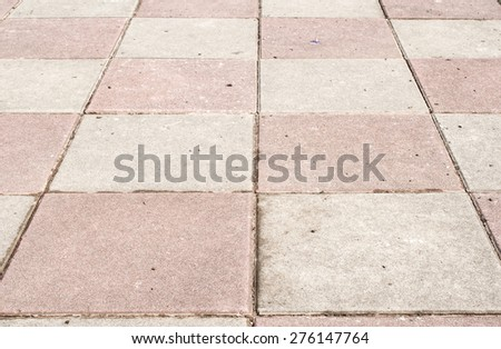 Classified stone's pink stripes on the pavement. - stock photo
