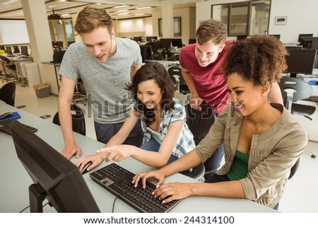 Classmates working together in the computer room at the university - stock photo