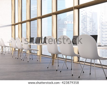Classroom interior with laptops on tables, chairs and Singapore city view. 3D Rendering