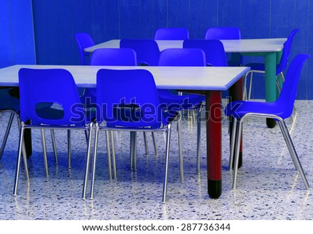 classroom of a kindergarten with blue chairs without chidlren