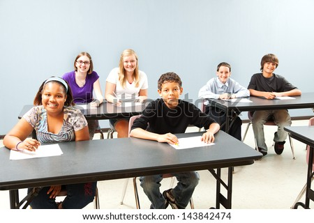 Classroom of diverse students.  Wide shot with plenty of room for text. - stock photo