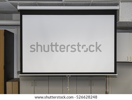 Classroom with an old fashioned pull down white screen