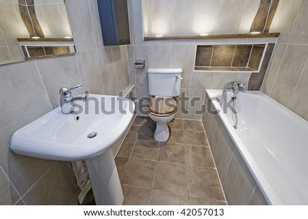 classy bathroom with hard wood details and ceramic tiles - stock photo