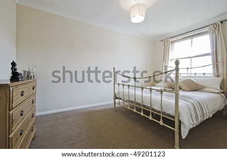 classy bedroom with stylish white metal bed frame and chest of drawers