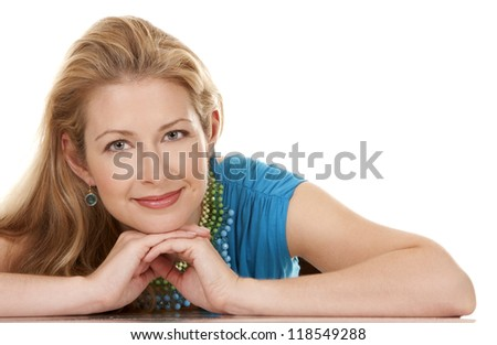 classy blond woman in her 40s wearing turquois dress - stock photo