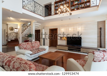 Classy house - elegant living room and a mezzanine - stock photo