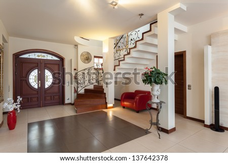 Classy house - entrance, living room and staircase - stock photo