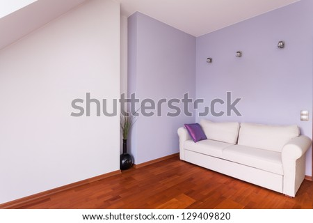 Classy house - Room with purple walls and white couch - stock photo