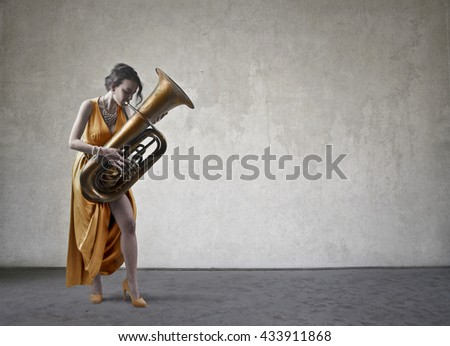 Classy lady playing an instrument - stock photo