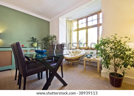 classy living area with dining table - stock photo