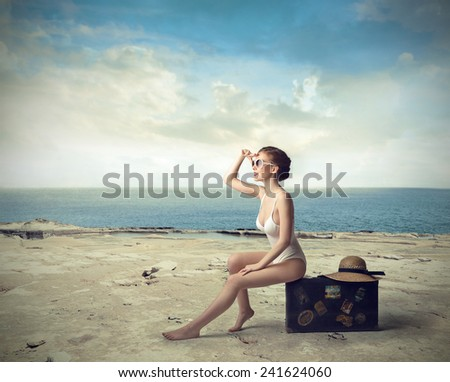 Classy woman at the beach  - stock photo