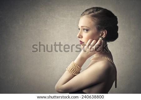 Classy woman wearing pearls  - stock photo